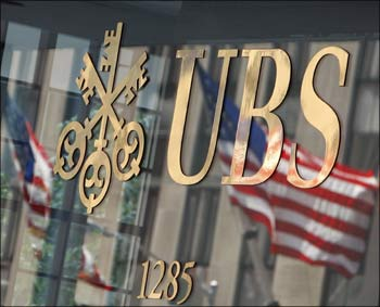 The US flag is seen in a reflection outside the Swiss bank UBS offices in New York.
