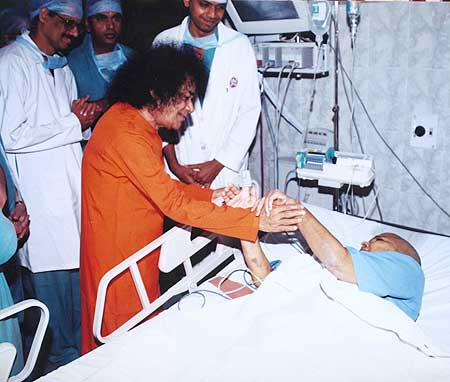 Sri Sathya Sai Baba with a patient