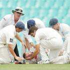 Australia batsman Hughes continues to fight for life