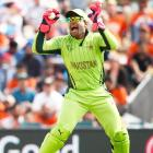 The strange case of Umar Akmal's gloves!