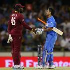 PHOTOS: Unbeaten India beat Windies, seal quarter-final berth