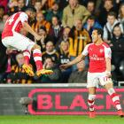 EPL PHOTOS: Arsenal coast past Hull, close in on Champions League berth