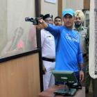 First Look: Dhoni goes shooting after practice washed out