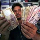 Rupee closes down 40 paise against dollar