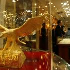Gold slips on global cues, silver surges