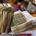 Rupee trims initial losses, still down by 6 paise