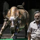 Sensex defies Greek bailout, reclaims 28,000