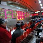 China stocks tumble as regulator warns of 'panic'