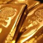 Gold extends losses; down Rs 100 on global cues, low demand