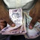 Rupee slips 5 paise to close at 67.11/USD