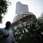 Markets continue to trade flat; Tata Motors up 3%
