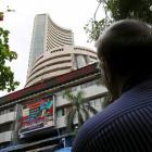 Sensex down over 100 points; bank shares drag