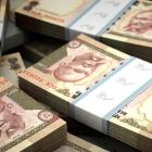 Rupee strengthens on wobbly dollar; up 4 paise at 66.61