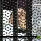 PIX: In a cage, Mubarak faces trial for murder