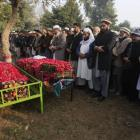 Day after: Mourners bury victims of Peshawar school massacre