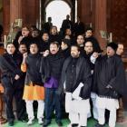 After black umbrellas, TMC brings black shawls to Parliament