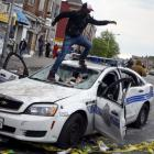 Baltimore riots: Violence, looting and fires engulf city