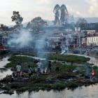 Mass cremations in Nepal as quake body count rises