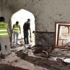 Pakistan: Death toll in bombing at Shiite mosque rises to 49