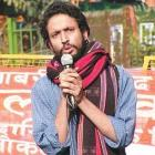 JNU student leader accused of rape surrenders before police