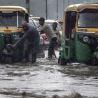 PHOTOS: Rains paralyse Gurugram again; water-logging in Delhi