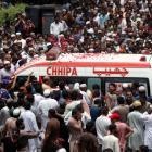 Tearful mourners attend slain qawwali singer's funeral in Pakistan