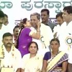 Fan love! Female admirer publicly kisses Siddaramaiah