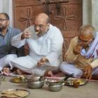 Eye on UP polls, Shah shares meal with Dalit family
