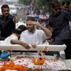 Shoe hurled at Rahul during roadshow; he pins the blame on BJP-RSS