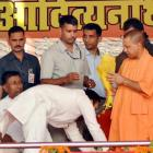 Adityanath draws flak for sharing stage with murder-accused MLA