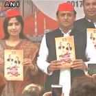 Releasing SP manifesto, Akhilesh says Modi only gave broom and yoga