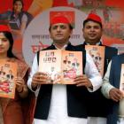 Akhilesh releases SP manifesto, Mulayam Singh absent