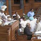 Parliament witnesses chaotic scenes as opposition takes on government