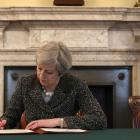 Theresa May signs letter to trigger Brexit