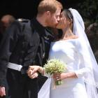 Sealed with a kiss! Harry and Meghan are husband and wife