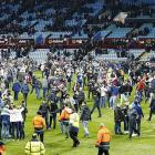 Villa charged following fans' pitch invasion