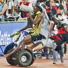 Champ Usain Bolt knocked down by photographer on Segway scooter!
