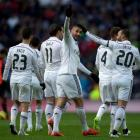Benzema double sends Real four points clear