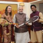 Paes, Hingis present PM Modi with autographed racquets