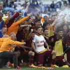 Dramatic derby win over Lazio sends Roma into Champions League