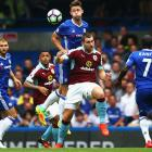 EPL PIX: Chelsea top after victory; Rose denies Liverpool win