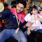 PIX: Junior Bachchan enjoys kabaddi match with wife and daughter