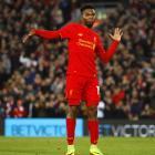 PHOTOS: Liverpool down Spurs, Arsenal through