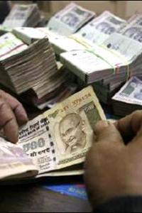 Rupee gains 11 paise against dollar