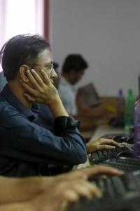 Sensex breaks 2-day rally, falls 100 points