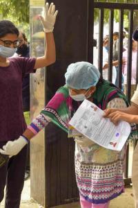 Masks, sanitiser: Students take NEET amid strict precautions