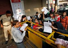 On Day 3, people 'endlessly wait' outside banks and ATMs for cash