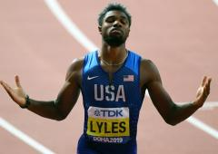 PHOTOS: Lyles brightens dark day with 200m gold