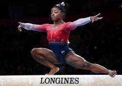 Biles rewrites history as US romp to fifth World title