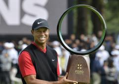 Woods wins in Japan, ties Snead for PGA Tour record